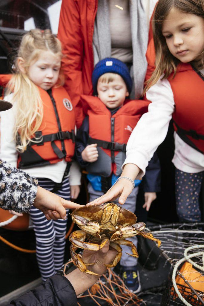 Kids touching a crab
