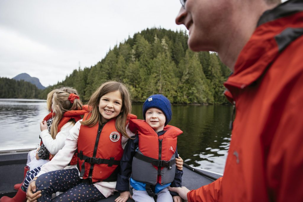 Kids smiling on a wilderness adventure