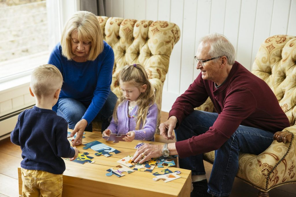 Family working on a puzzle in their cabin