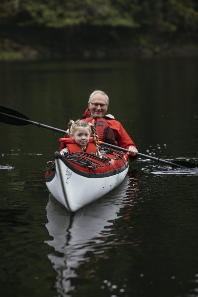 Grand parent and child on a canoe